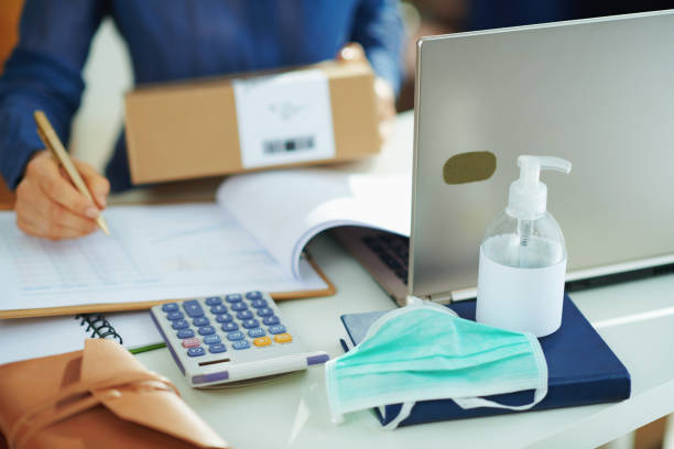 medical mask and hand disinfectant and woman with parcel stock photo