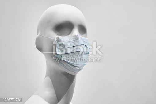 Medical mask mannequin - quarantine concept. Close up.