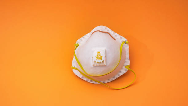 Medical mask on a colored background stock photo