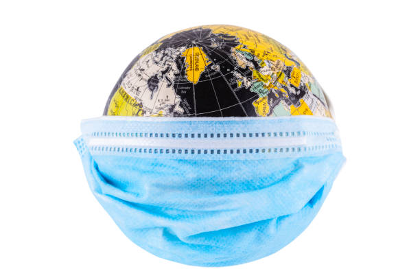 Medical Mask on earth stock photo