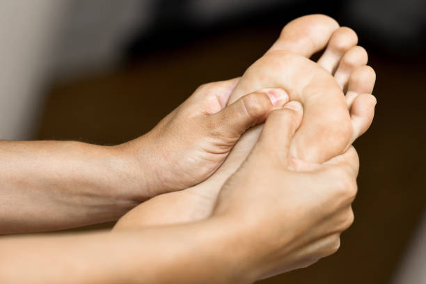 Medical massage at the foot in a physiotherapy center. stock photo