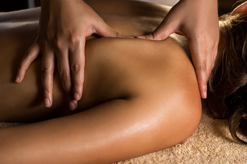 Medical massage closeup with beautiful charming light.