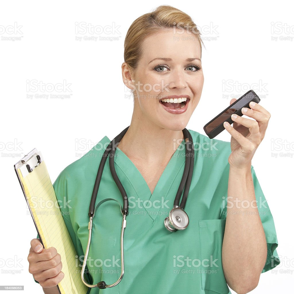 Medical Nurse dictating into a smart phone stock photo