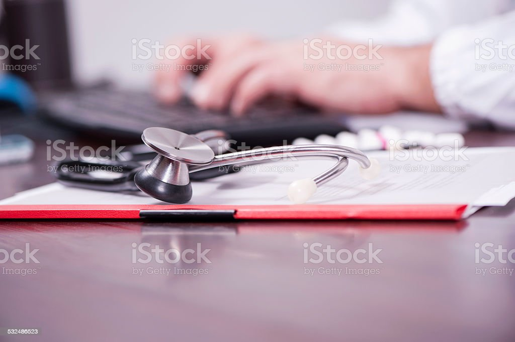 Medical person typing stock photo