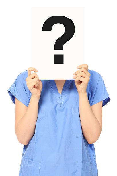 medical person with a question - question mark asking doctor nurse stock photos and pictures