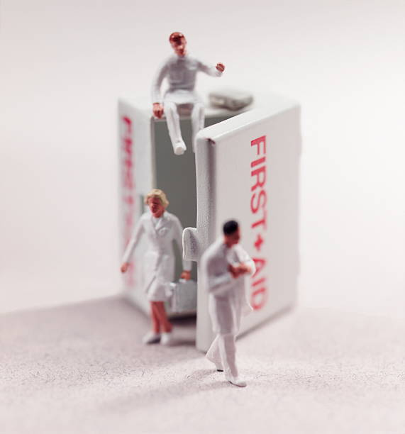 Medical Personnel Coming Out of First Aid Kit stock photo