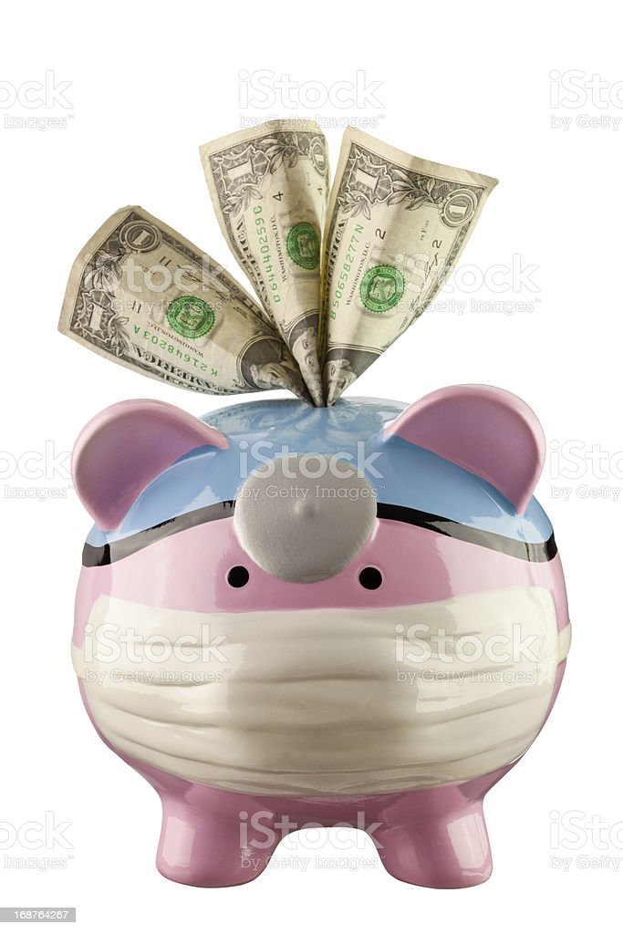 Medical Piggy Bank With Dollar Bills In Slot royalty-free stock photo