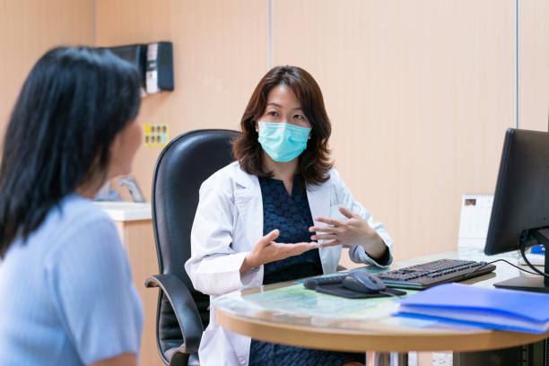 Medical practitioner explaining patient at office stock photo
