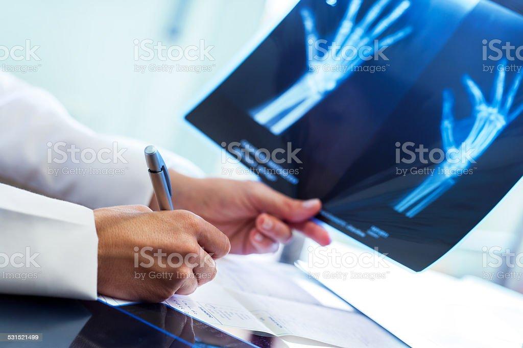 Medical practitioner writing prescription. stock photo