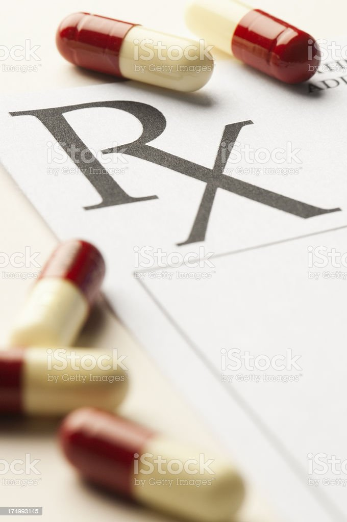 RX Medical prescription with pills scattered around it royalty-free stock photo