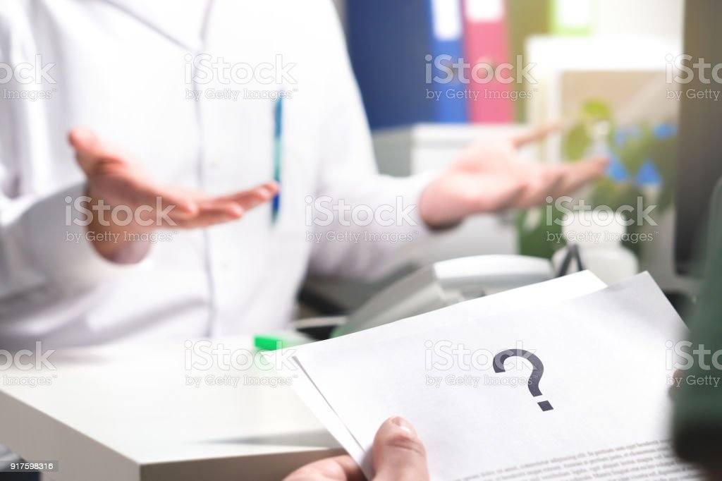 Medical problem. Patient reading health care document with question mark. New or unknown disease. Can't find or no cure for illness. Wrong diagnosis. royalty-free stock photo