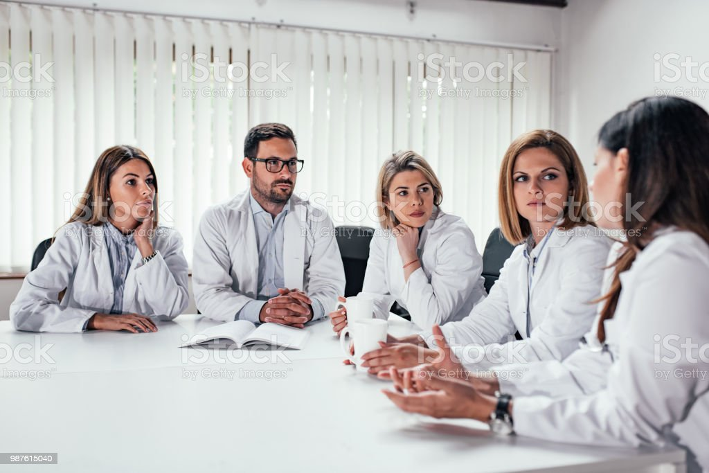 Medical professional during the meeting in the conference room. stock photo