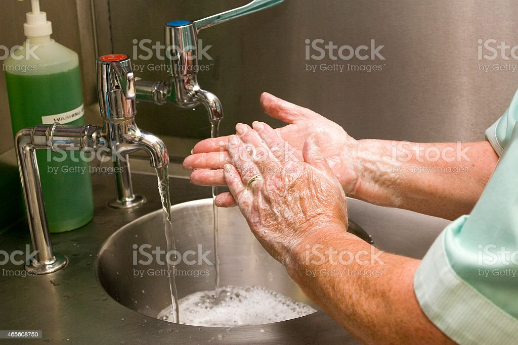 Medical Professional Washing Hands stock photo