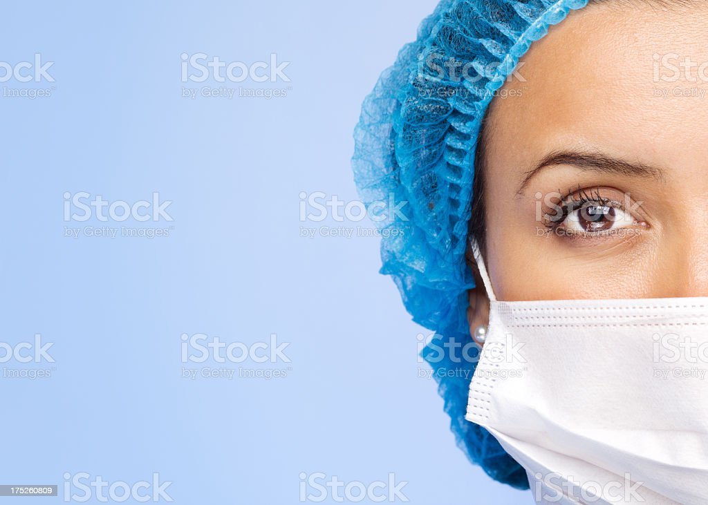 Medical professional wearing a doctors mask  royalty-free stock photo