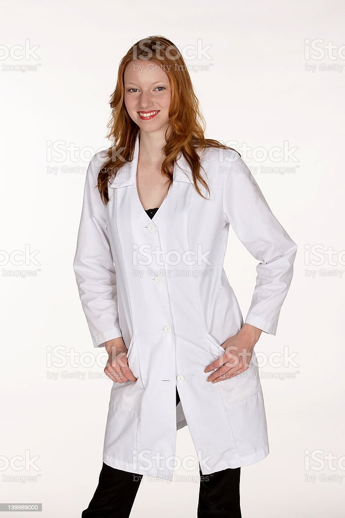 Medical Professional with Hands in Lab Coat Pockets royalty-free stock photo
