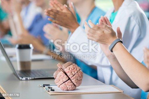istock Medical professionals applaud during seminar 637181776