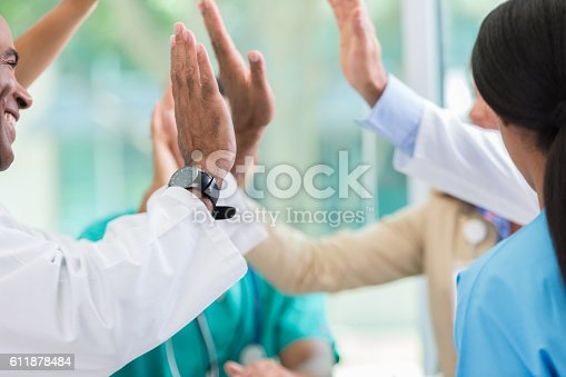 istock Medical professionals give high fives 611878484