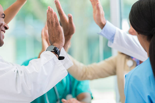 Medical professionals give high fives - foto stock
