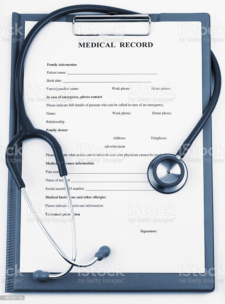 A medical record with a stethoscope stock photo