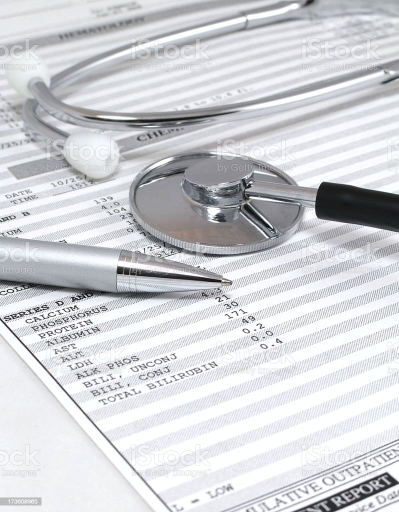Test results and stethoscope on a doctor\'s desk