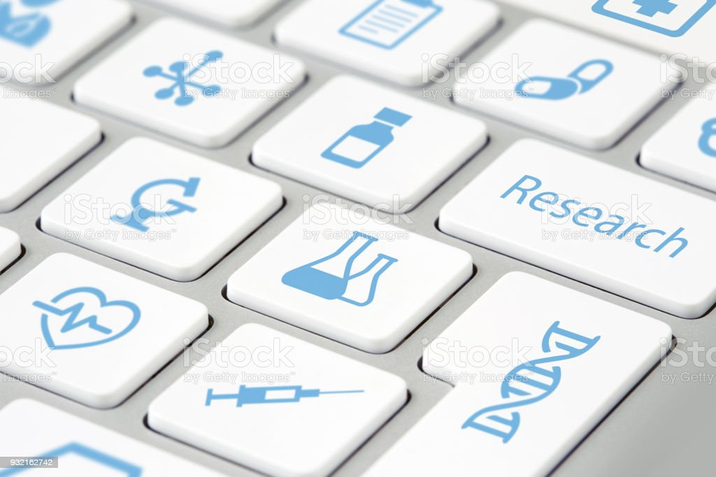 medical research icons on keyboard buttons stock photo