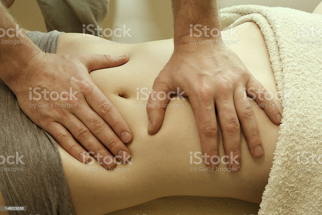 medical sap abdominal massage medical spa abdominal belly massage 20-29 Years Stock Photo