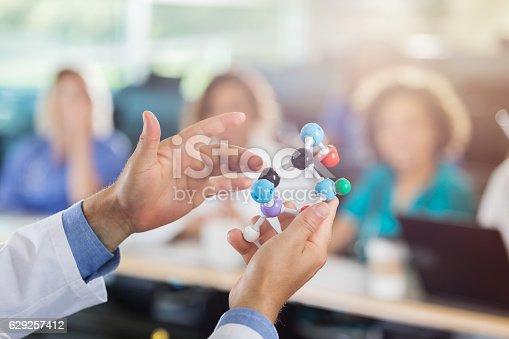 istock Medical school professor uses molecular model in class 629257412
