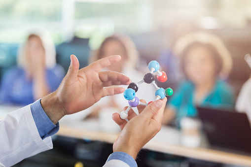 istock Medical school professor uses molecular model in class 629257412