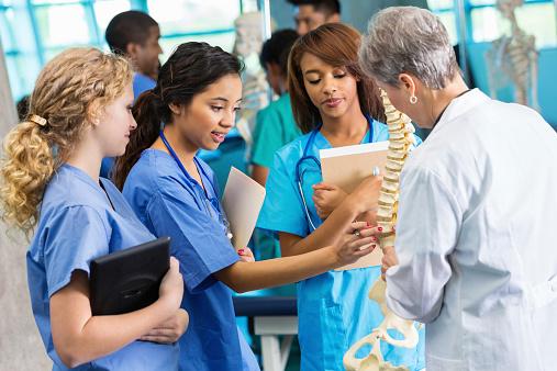 Medical school professor using model to teach nursing students