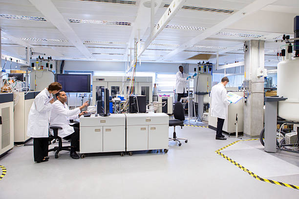medical science professionals working in a laboratory - laboratory stock photos and pictures