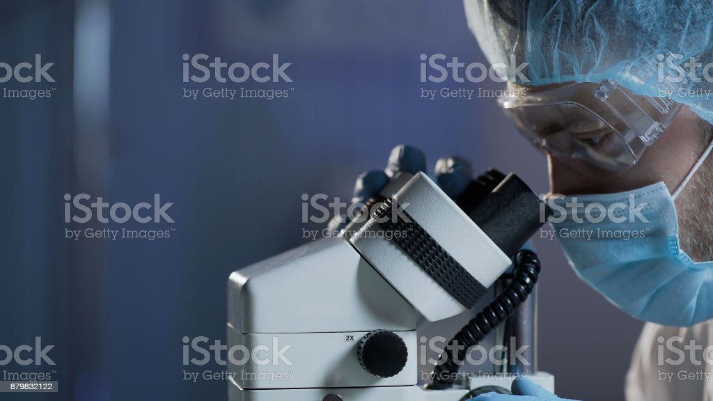 Medical scientist conducting research of blood sample for hematologic diseases stock photo