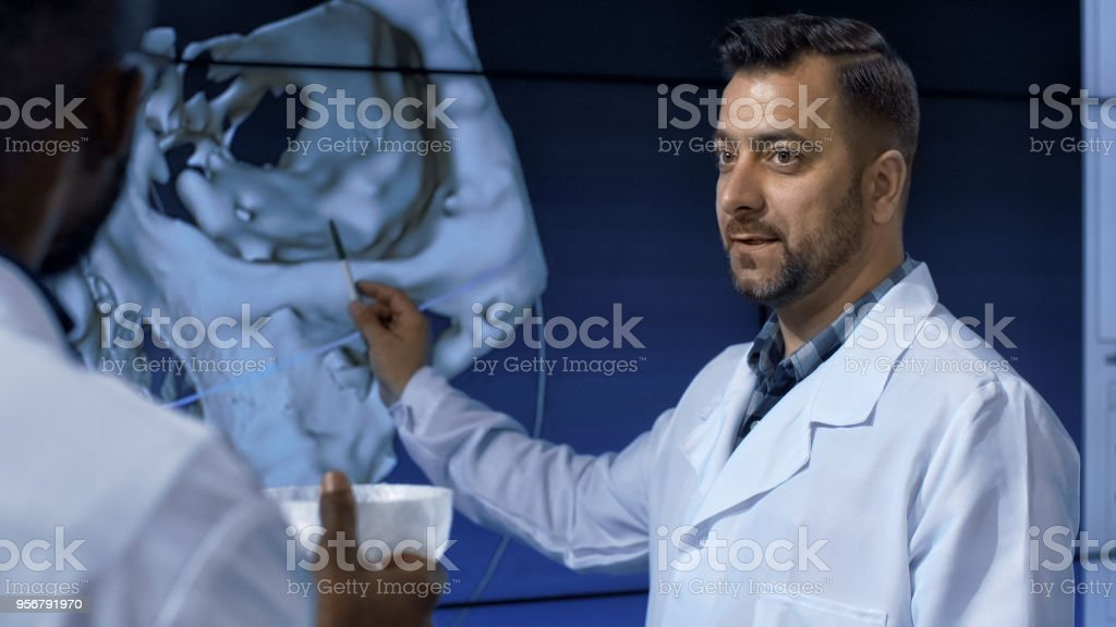 Medical scientists investigating human skull stock photo