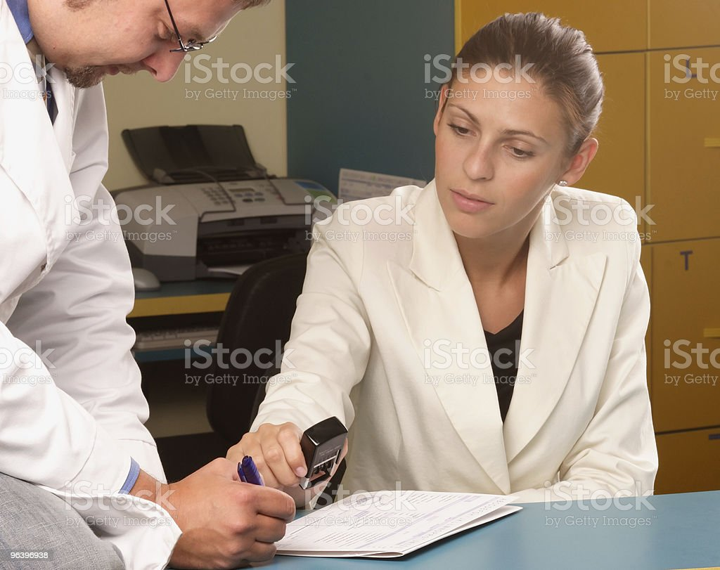Medical secretary and doctor working together - Royalty-free Adult Stock Photo
