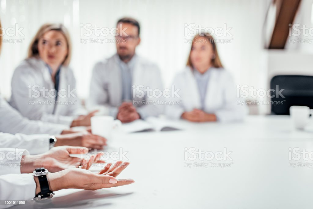 Medical staff discussing at the table. Copy space. stock photo