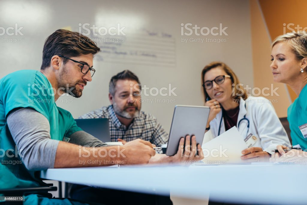 Medical staff having morning meeting in boardroom stock photo
