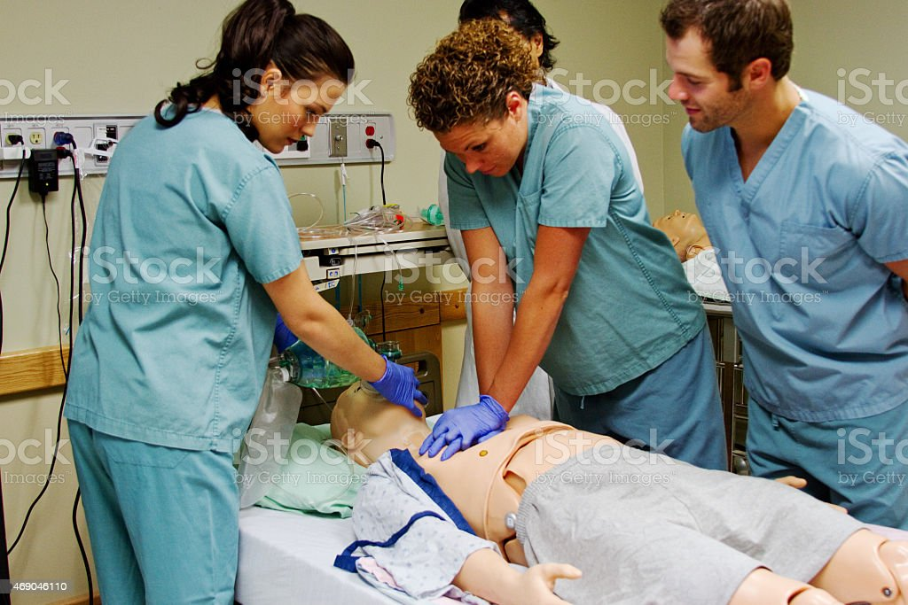 Medical staff practicing CPR stock photo
