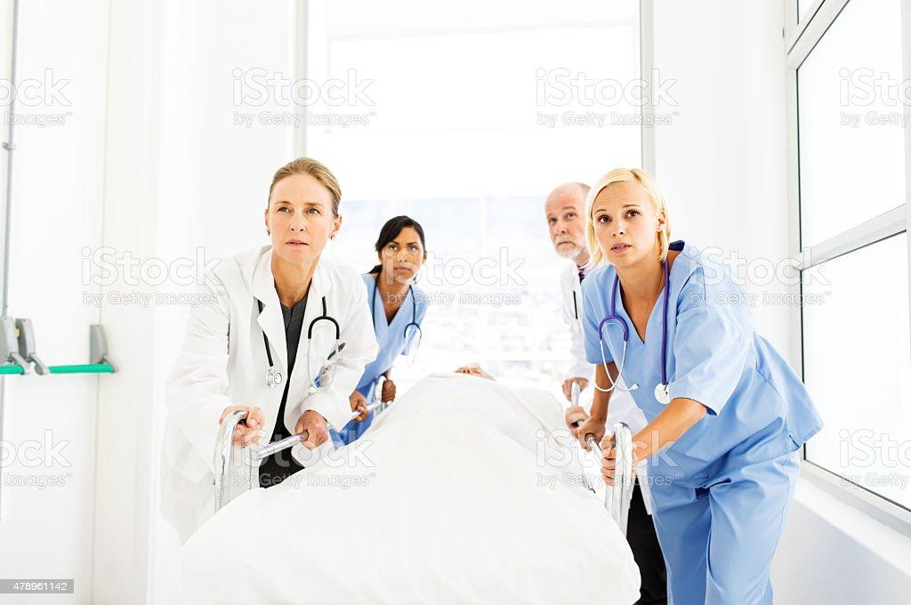 Medical Staff Pushing Patient On Hospital Gurney stock photo