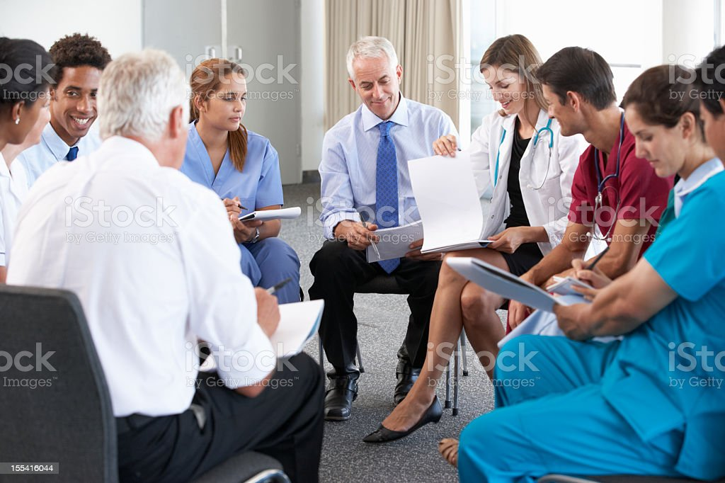 Medical Staff Seated In Circle At Case Meetin royalty-free stock photo