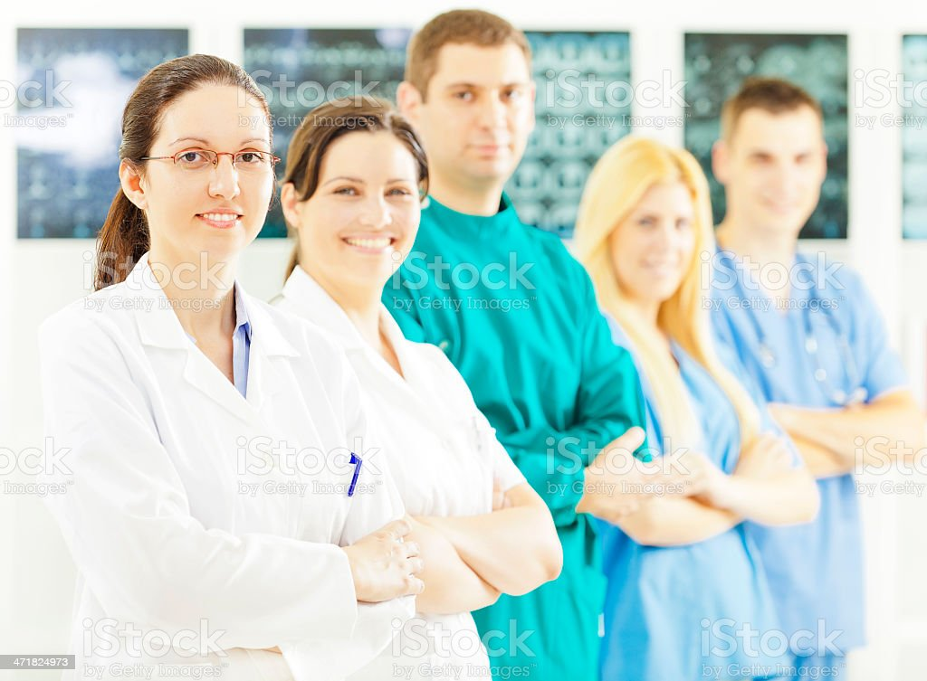 Medical staff standing in radiology practice royalty-free stock photo