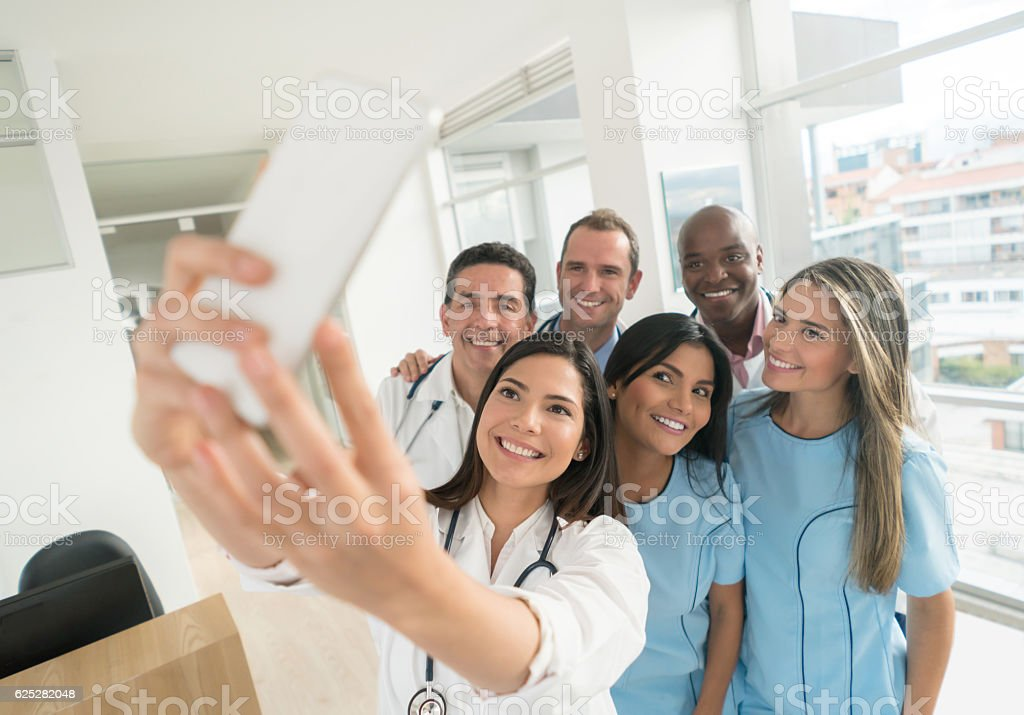 Medical staff taking a selfie at the hospital stock photo
