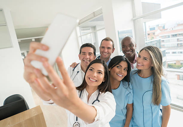 Medical staff taking a selfie at the hospital - Photo
