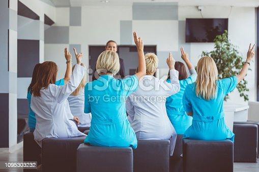 933450738 istock photo Medical staff voting on seminar 1095303232
