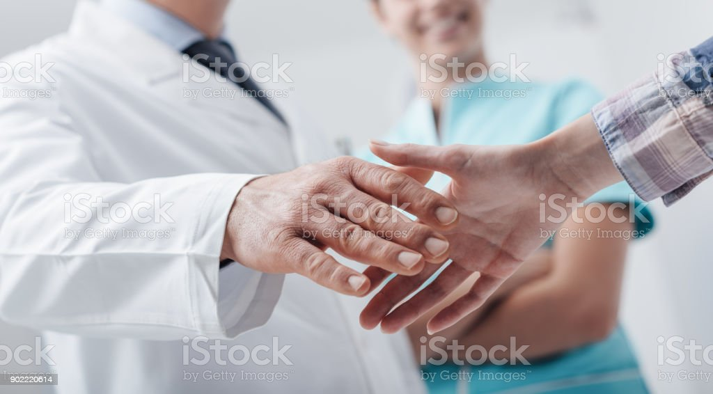 Medical staff welcoming a patient stock photo