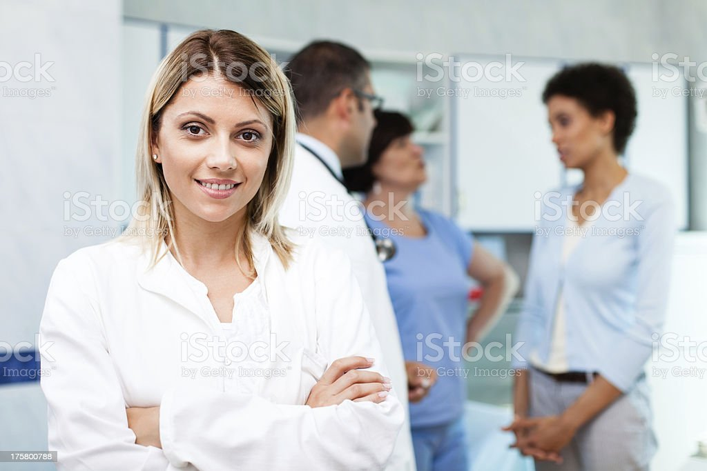 Medical staff with patient in doctor's office royalty-free stock photo