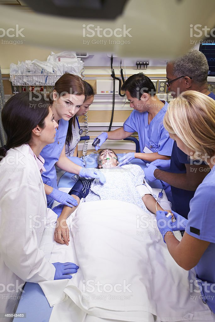 Medical staff working on a patient in the emergency room stock photo