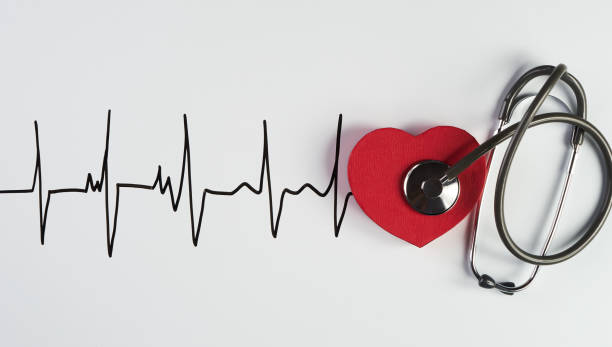medical stethoscope and red heart with cardiogram - taking pulse stock photos and pictures