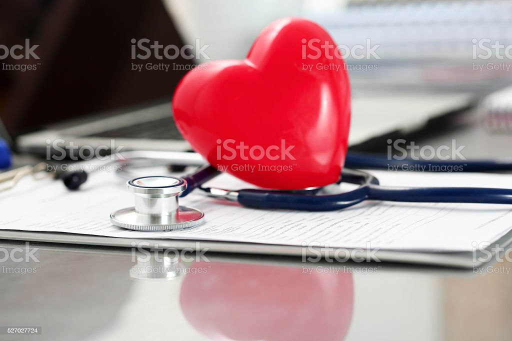 Medical stethoscope head and red toy heart stock photo