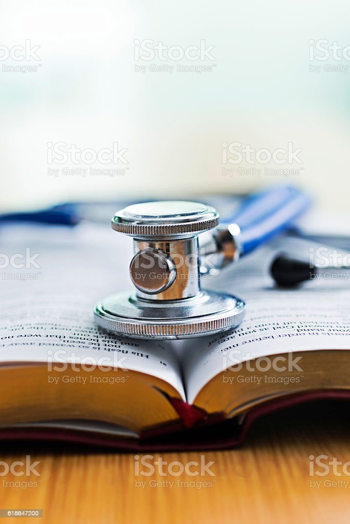 Medical stethoscope on a book stock photo