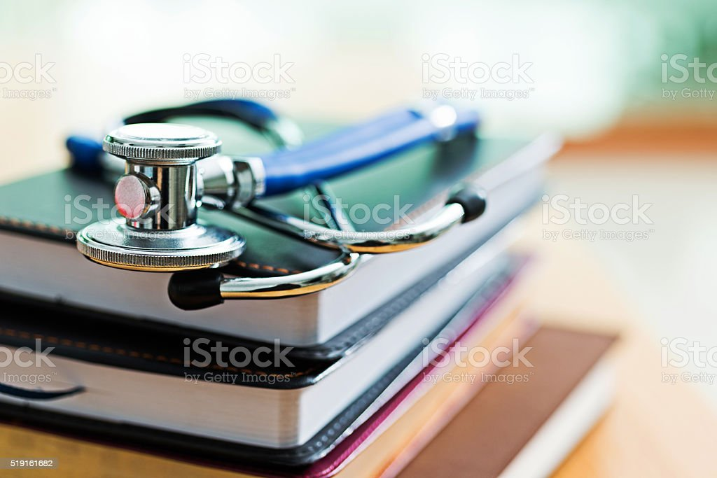 Medical stethoscope on books stock photo