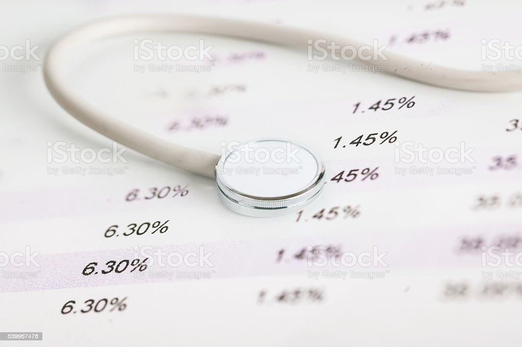 Medical stethoscope on financial report stock photo